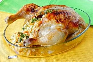 Курица, фаршированная рисом, в духовке